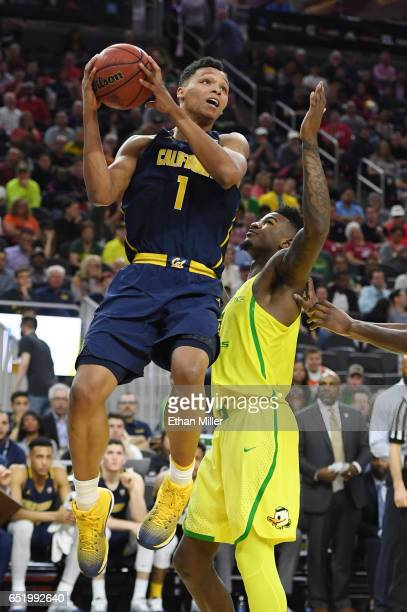 Ivan Rabb of the California Golden Bears goes to the basket against Jordan Bell of the Oregon Ducks during a semifinal game of the Pac12 Basketball...