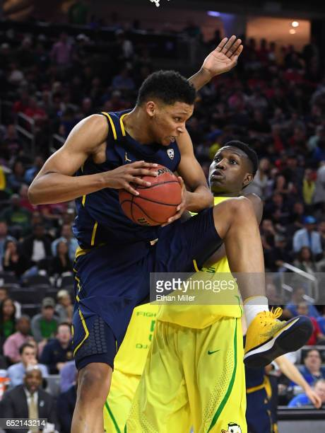 Ivan Rabb of the California Golden Bears grabs a rebound against Chris Boucher of the Oregon Ducks during a semifinal game of the Pac12 Basketball...