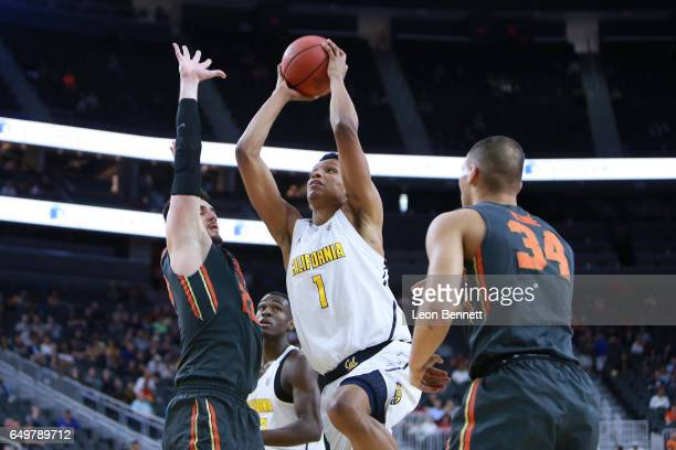 Ivan Rabb of the California Golden Bears handles the ball against Gligorije Rakocevic of the Oregon State Beavers during a firstround game of the...