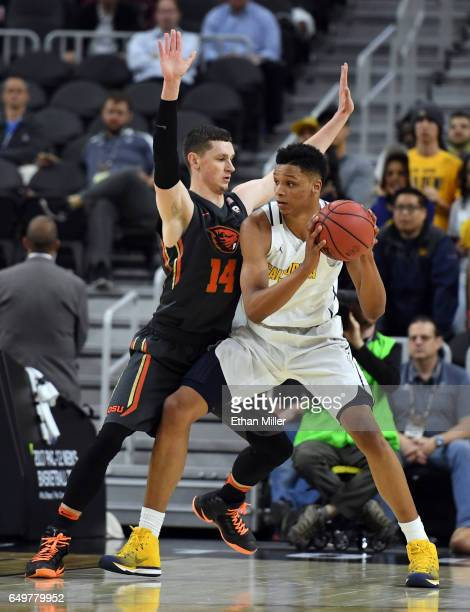 Ivan Rabb of the California Golden Bears is fouled by Matt Dahlen of the Oregon State Beavers during a firstround game of the Pac12 Basketball...