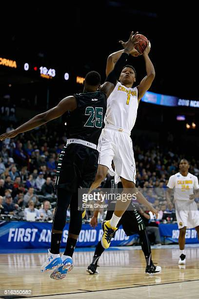 Ivan Rabb of the California Golden Bears puts up a shot over Michael Thomas of the Hawaii Warriors in the first half during the first round of the...