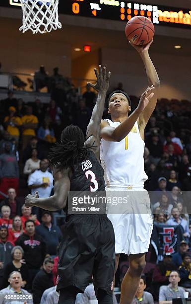 Ivan Rabb of the California Golden Bears shoots against Angelo Chol of the San Diego State Aztecs during the 2015 Continental Tire Las Vegas...