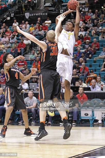 Ivan Rabb of the California Golden Bears shoots the ball for two over Olaf Schaftenaar of the Oregon State Beavers during a quarterfinal game of the...