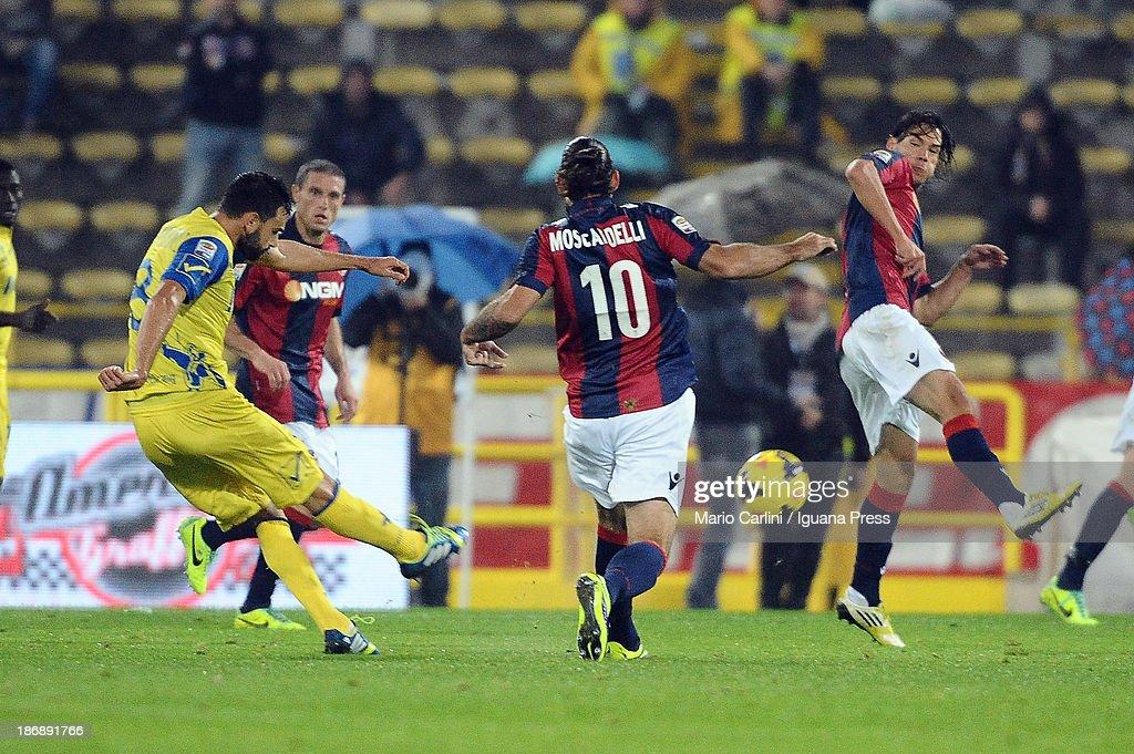 Ivan Radovanovic # 8 of AC Chievo Verona kicks on goal during the Serie A match between Bologna FC and AC Chievo Verona at Stadio Renato Dall'Ara on November 4, 2013 in Bologna, Italy.