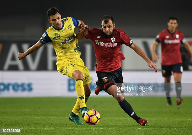 Ivan Radovanovic of AC ChievoVerona competes for the ball with Goran Pandev of Genoa CFC during the Serie A match between AC ChievoVerona and Genoa...