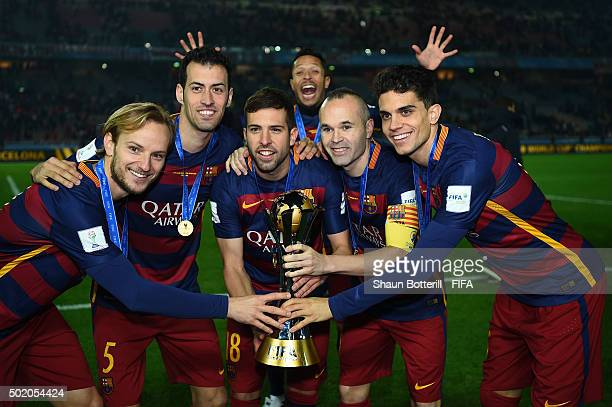 Ivan Rakatic Sergio Buequets Jordi Alba Adriano Andres Iniesta and Marc Bartra of Barcelona celebrate with the trophy following their team's 30...
