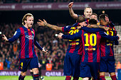 Ivan Rakitic and Andres Iniesta of FC Barcelona celebrate with their teammates after Neymar Santos Jr scored the opening goal during the La Liga...