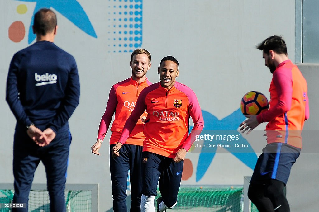 Ivan Rakitic and Neymar Jr. take part in a training session at the Sports Center FC Barcelona Joan Gamper, before the Spanish League match between F.C Barcelona and Málaga C.F, on November 18, 2016 in Barcelona, Spain.