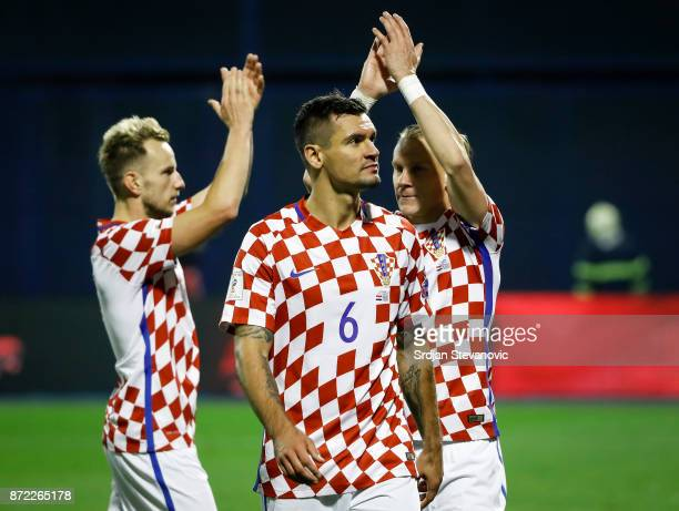 Ivan Rakitic Dejan Lovren and Domagoj Vida of Croatia celebrate after winning the FIFA 2018 World Cup Qualifier PlayOff First Leg match between...