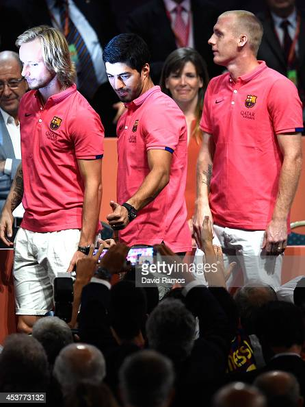 Ivan Rakitic Luis Suarez and Jeremy Mathieu of FC Barcelona acknowledge the FC Barcelona supporters during the new FC Barcelona players presentation...