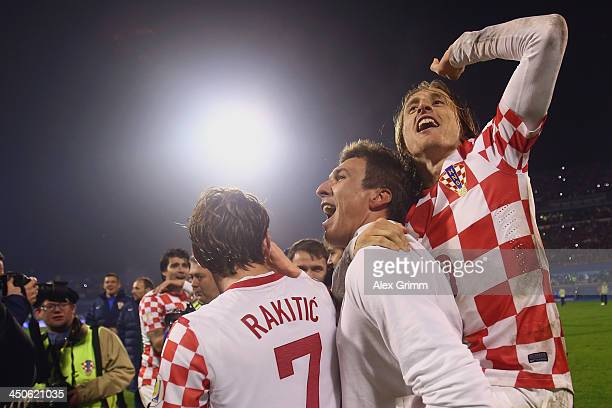 Ivan Rakitic Mario Mandzukic and Luka Modric of Croatia celebrate after the FIFA 2014 World Cup Qualifier playoff second leg match between Croatia...