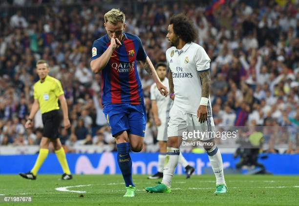 Ivan Rakitic of Barcelona celebrates as he scores their second goal during the La Liga match between Real Madrid CF and FC Barcelona at Estadio...