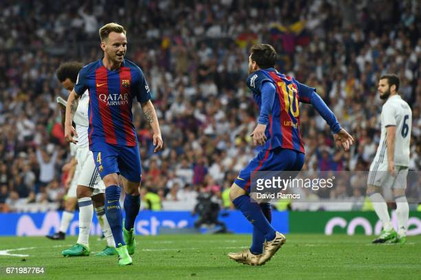 Ivan Rakitic of Barcelona celebrates as he scores their second goal with Lionel Messi of Barcelona during the La Liga match between Real Madrid CF...