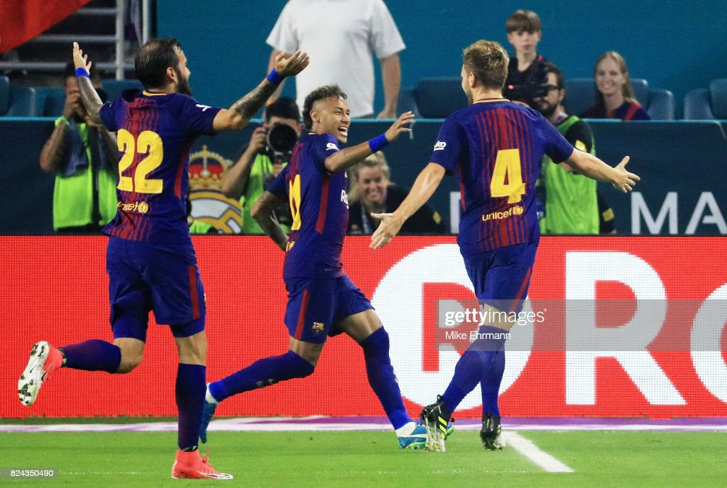 Ivan Rakitic #4 of Barcelona celebrates his goal with teammates Neymar #11 and Aleix Vidal #22 in the first half against the Real Madrid during their International Champions Cup 2017 match at Hard Rock Stadium on July 29, 2017 in Miami Gardens, Florida.