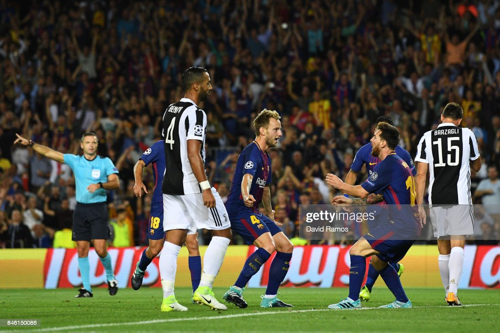 Ivan Rakitic of Barcelona celebrates scoring his sides second goal with Lionel Messi of Barcelona during the UEFA Champions League Group D match between FC Barcelona and Juventus at Camp Nou on September 12, 2017 in Barcelona, Spain.