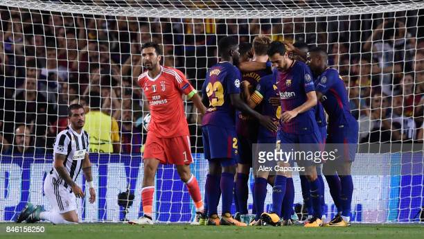 Ivan Rakitic of Barcelona celebrates scoring his sides second goal with his Barcelona team mates as Gianluigi Buffon of Juventus reacts during the...