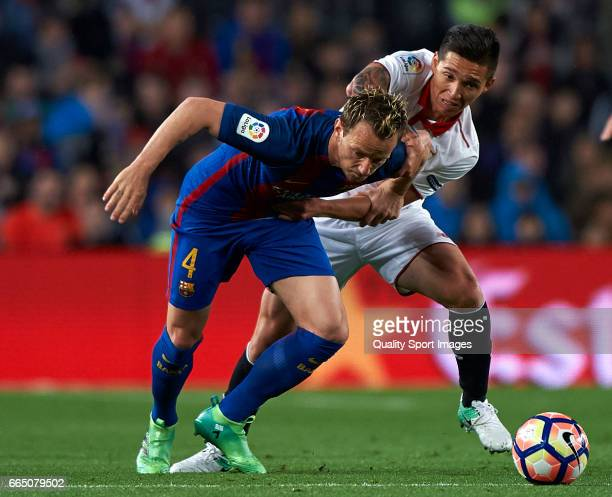 Ivan Rakitic of Barcelona competes for the ball with Matias Kranevitter of Sevilla during the La Liga match between FC Barcelona and Sevilla FC at...
