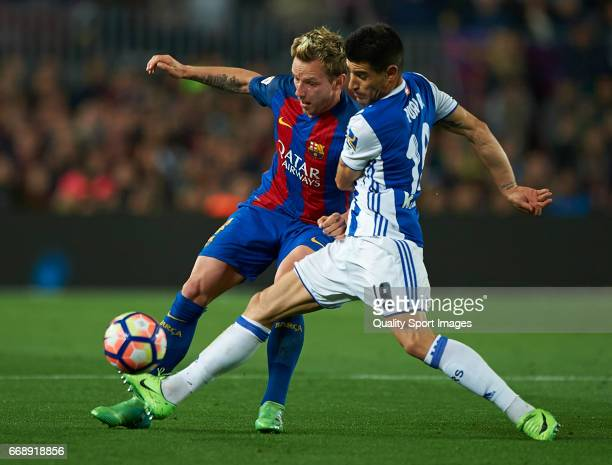 Ivan Rakitic of Barcelona competes for the ball with Yuri Berchiche Izeta of Real Sociedad during the La Liga match between FC Barcelona and Real...