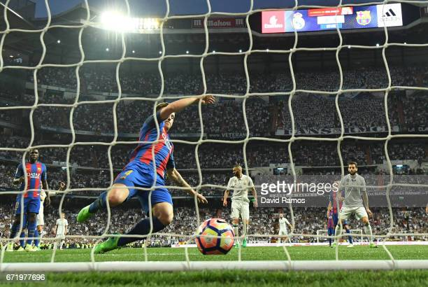 Ivan Rakitic of Barcelona fails to stop Casemiro of Real Madrid from scoring their first goal during the La Liga match between Real Madrid CF and FC...