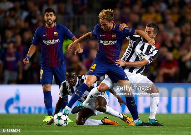 Ivan Rakitic of Barcelona is tackled by Miralem Pjanic of Juventus during the UEFA Champions League group D match between FC Barcelona and Juventus...