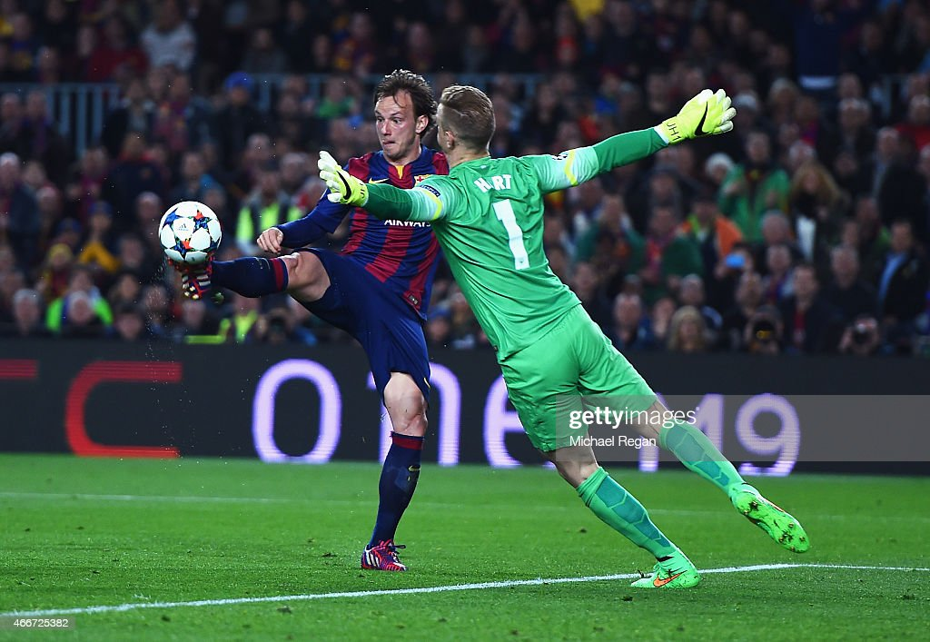 <a gi-track='captionPersonalityLinkClicked' href=/galleries/search?phrase=Ivan+Rakitic&family=editorial&specificpeople=3987920 ng-click='$event.stopPropagation()'>Ivan Rakitic</a> of Barcelona lifts the ball over <a gi-track='captionPersonalityLinkClicked' href=/galleries/search?phrase=Joe+Hart&family=editorial&specificpeople=1295472 ng-click='$event.stopPropagation()'>Joe Hart</a> of Manchester City to score the opening goal during the UEFA Champions League Round of 16 second leg match between Barcelona and Manchester City at Camp Nou on March 18, 2015 in Barcelona, Spain.