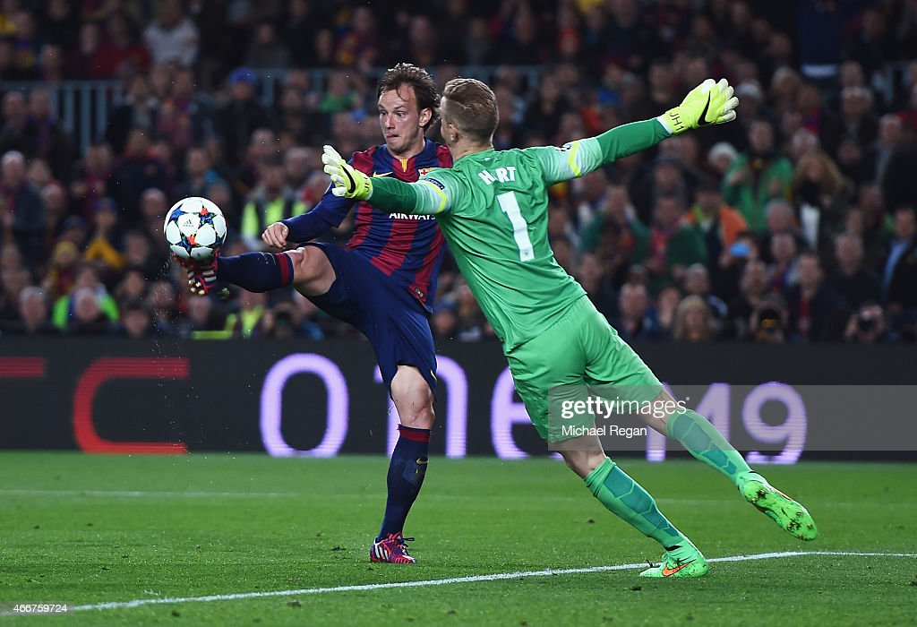Ivan Rakitic of Barcelona lifts the ball over Joe Hart of Manchester City to score the opening goal during the UEFA Champions League Round of 16 second leg match between Barcelona and Manchester City at Camp Nou on March 18, 2015 in Barcelona, Spain.