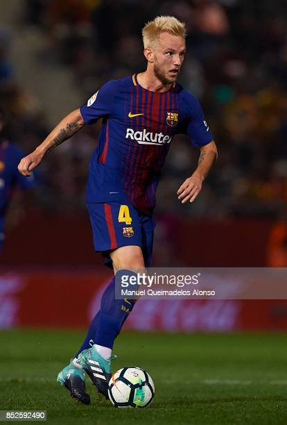 Ivan Rakitic of Barcelona runs with the ball during the La Liga match between Girona and Barcelona at Municipal de Montilivi Stadium on September 23...