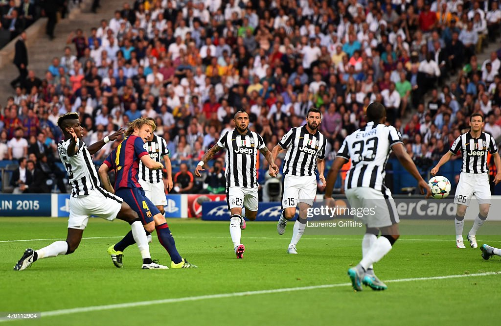 <a gi-track='captionPersonalityLinkClicked' href=/galleries/search?phrase=Ivan+Rakitic&family=editorial&specificpeople=3987920 ng-click='$event.stopPropagation()'>Ivan Rakitic</a> of Barcelona scores the opening goal during the UEFA Champions League Final between Juventus and FC Barcelona at Olympiastadion on June 6, 2015 in Berlin, Germany.