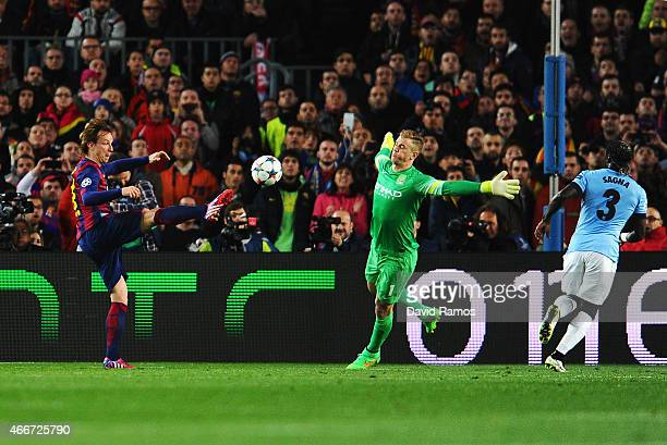 Ivan Rakitic of Barcelona scores the opening goal past Joe Hart of Manchester City during the UEFA Champions League Round of 16 second leg match...