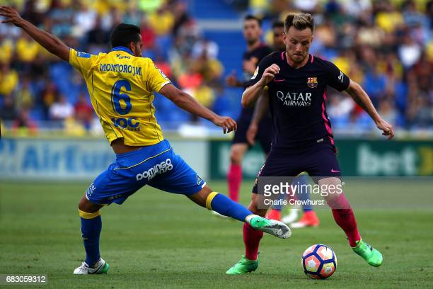 Ivan Rakitic of Barcelona skips past the tackle from Angel Montoro of Las Palmas during the La Liga match between UD Las Palmas and Barcelona at...
