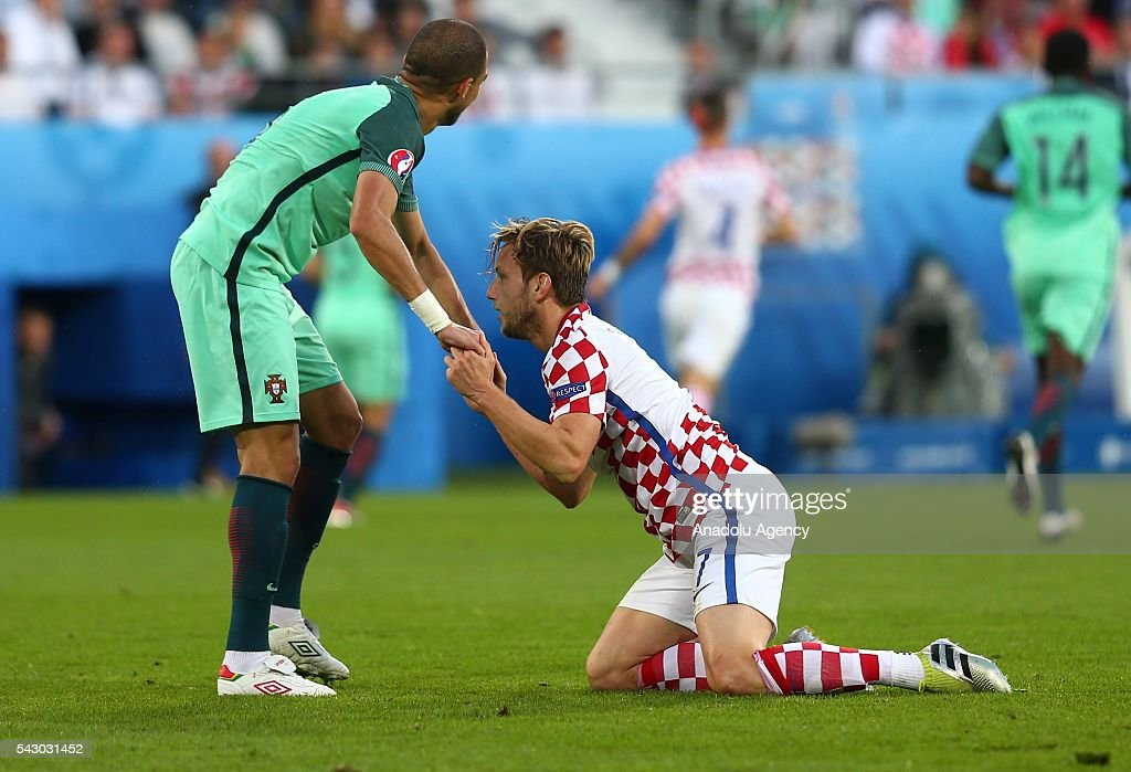 Ivan Rakitic (R) of Croatia and against Pepe (L) of Portugal are seen during the Euro 2016 round of 16 football match between Croatia and Portugal at Stade Bollaert-Delelis in Lens, France on June 25, 2016.