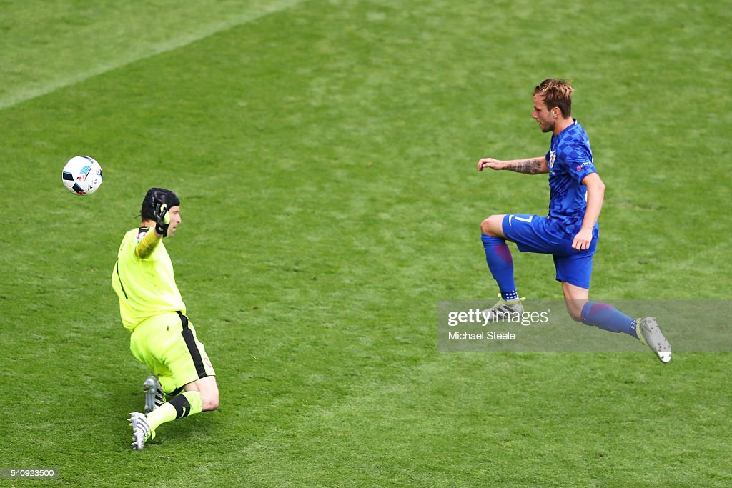 Ivan Rakitic of Croatia chips Petr Cech of Czech Republic to score his sides second goal during the UEFA EURO 2016 Group D match between Czech Republic and Croatia at Stade Geoffroy-Guichard on June 17, 2016 in Saint-Etienne, France.