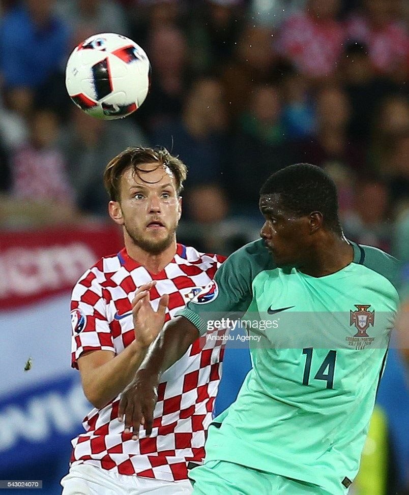 Ivan Rakitic (L) of Croatia in action against William Carvalho (R) of Portugal during the Euro 2016 round of 16 football match between Croatia and Portugal at Stade Bollaert-Delelis in Lens, France on June 25, 2016.