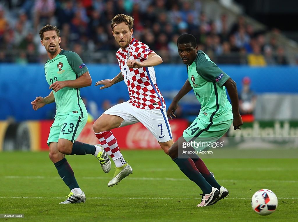 Ivan Rakitic (C) of Croatia in action against William Carvalho (R) of Portugal during the Euro 2016 round of 16 football match between Croatia and Portugal at Stade Bollaert-Delelis in Lens, France on June 25, 2016.