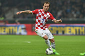 Ivan Rakitic of Croatia in action during the EURO 2016 Group H Qualifier match between Italy and Croatia at Stadio Giuseppe Meazza on November 16...