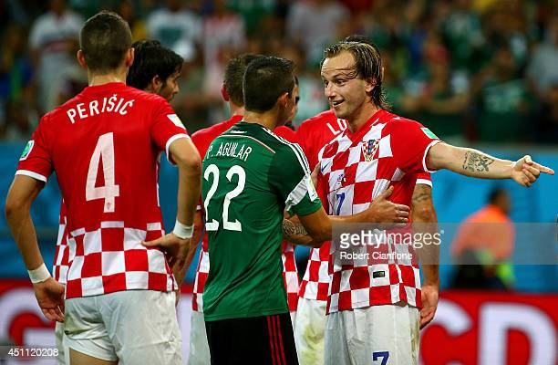 Ivan Rakitic of Croatia reacts toward Paul Aguilar of Mexico during the 2014 FIFA World Cup Brazil Group A match between Croatia and Mexico at Arena...