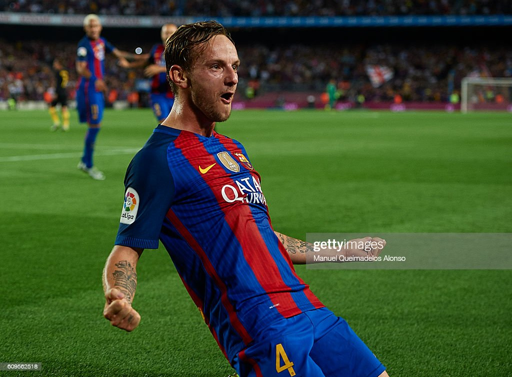 Ivan Rakitic of FC Barcelona celebrates scoring his team's first goal during the La Liga match between FC Barcelona and Atletico de Madrid at Camp Nou stadium on September 21, 2016 in Barcelona, Spain.