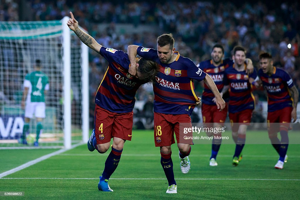 <a gi-track='captionPersonalityLinkClicked' href=/galleries/search?phrase=Ivan+Rakitic&family=editorial&specificpeople=3987920 ng-click='$event.stopPropagation()'>Ivan Rakitic</a> (L) of FC Barcelona celebrates scoring their opening goal with teammate <a gi-track='captionPersonalityLinkClicked' href=/galleries/search?phrase=Jordi+Alba&family=editorial&specificpeople=5437949 ng-click='$event.stopPropagation()'>Jordi Alba</a> (2ndL) during the La Liga match between Real Betis Balompie and FC Barcelona at Estadio Benito Villamarin on April 30, 2016 in Seville, Spain.