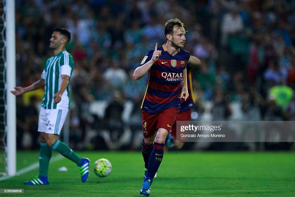 <a gi-track='captionPersonalityLinkClicked' href=/galleries/search?phrase=Ivan+Rakitic&family=editorial&specificpeople=3987920 ng-click='$event.stopPropagation()'>Ivan Rakitic</a> of FC Barcelona celebrates scoring their opening goal during the La Liga match between Real Betis Balompie and FC Barcelona at Estadio Benito Villamarin on April 30, 2016 in Seville, Spain.