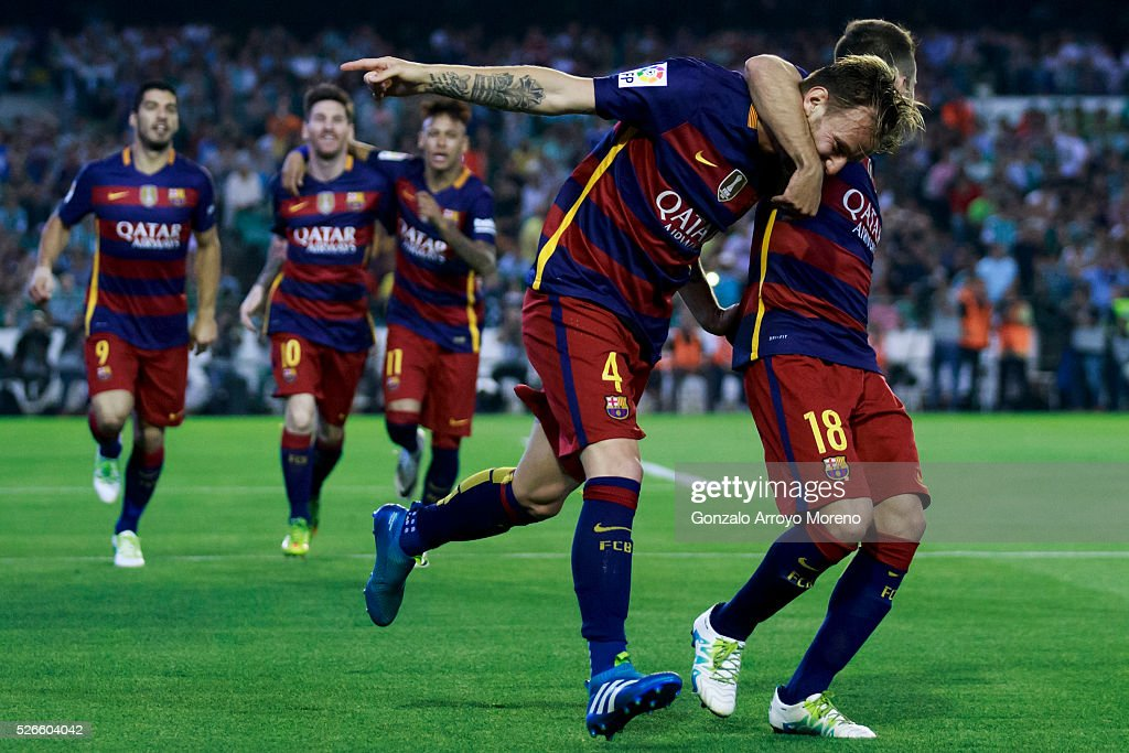 Ivan Rakitic of FC Barcelona celebrates scoring their opening goal with teammate Jordi Alba during the La Liga match between Real Betis Balompie and...