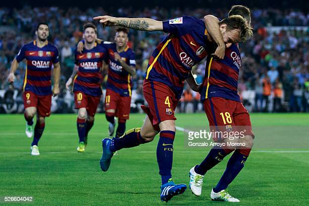 Ivan Rakitic of FC Barcelona celebrates scoring their opening goal with teammate Jordi Alba during the La Liga match between Real Betis Balompie and...