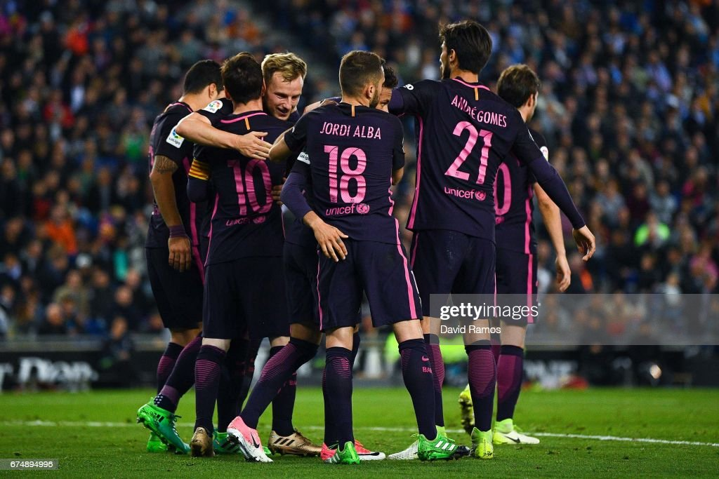 Ivan Rakitic of FC Barcelona (3dL) celebrates with his team mates after scoring his team's second goal during the La Liga match between RCD Espanyol and FC Barcelona at the RCDE Stadium on April 29, 2017 in Barcelona, Spaain.