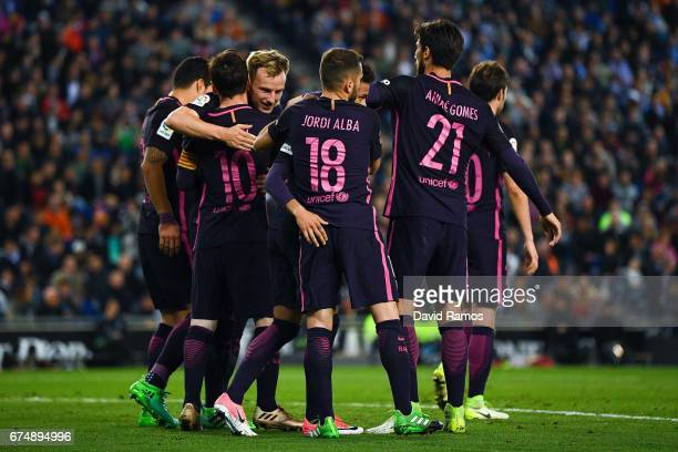 Ivan Rakitic of FC Barcelona celebrates with his team mates after scoring his team's second goal during the La Liga match between RCD Espanyol and FC...