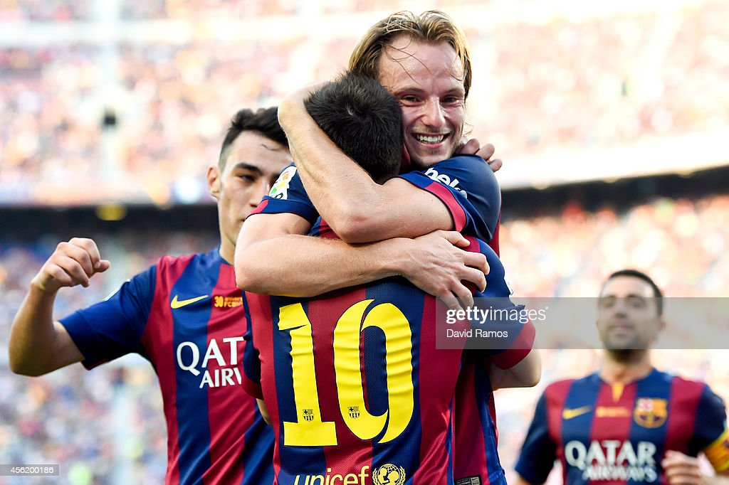<a gi-track='captionPersonalityLinkClicked' href=/galleries/search?phrase=Ivan+Rakitic&family=editorial&specificpeople=3987920 ng-click='$event.stopPropagation()'>Ivan Rakitic</a> of FC Barcelona celebrates with his teammate <a gi-track='captionPersonalityLinkClicked' href=/galleries/search?phrase=Lionel+Messi&family=editorial&specificpeople=453305 ng-click='$event.stopPropagation()'>Lionel Messi</a> of FC Barcelona after scoring his team's second goal during the La Liga match between FC Barcelona and Granada CF at Camp Nou on September 27, 2014 in Barcelona, Spain.