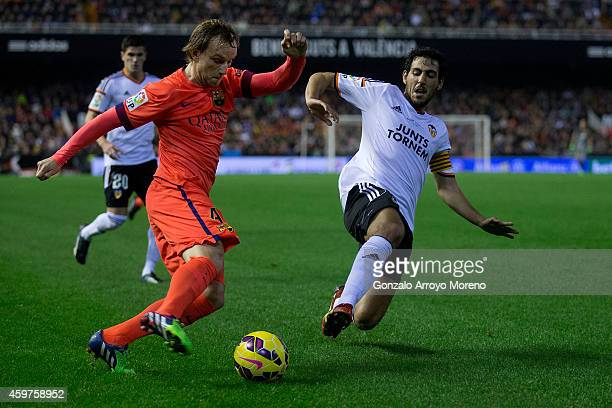 Ivan Rakitic of FC Barcelona competes for the ball with Dani Parejo of Valencia CF during the La Liga match between Valencia CF and FC Barcelona at...