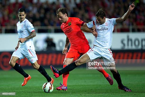 Ivan Rakitic of FC Barcelona competes for the ball with Grzegorz Krychowiak of Sevilla FC during the La Liga match between Sevilla FC and FC...