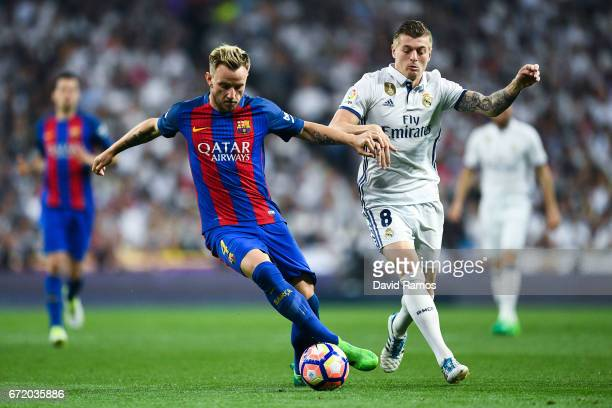 Ivan Rakitic of FC Barcelona competes for the ball with Toni Kroos of Real Madrid CF during the La Liga match between Real Madrid CF and FC Barcelona...