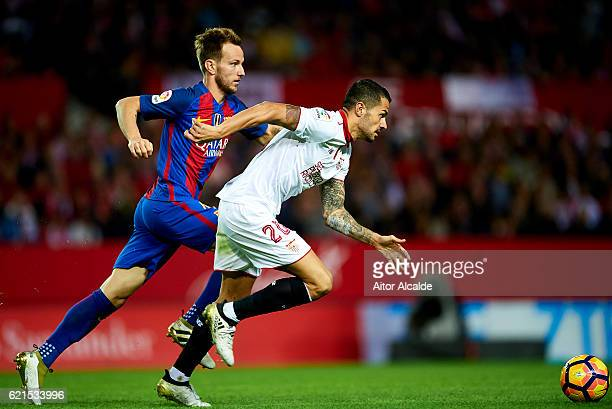 Ivan Rakitic of FC Barcelona competes for the ball with Victor Machin Perez 'Vitolo' of Sevilla FC during the match between Sevilla FC vs FC...