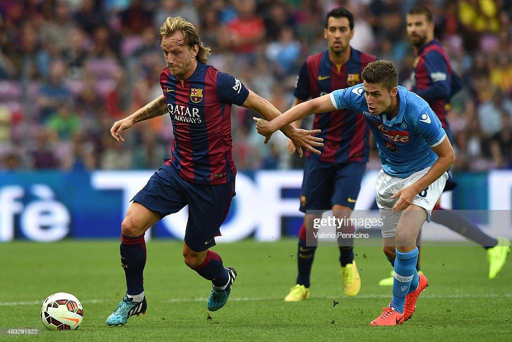 Ivan Rakitic (L) of FC Barcelona competes with Jorginho of SSC Napoli during the pre-season friendly match between FC Barcelona and SSC Napoli on August 6, 2014 in Geneva, Switzerland.