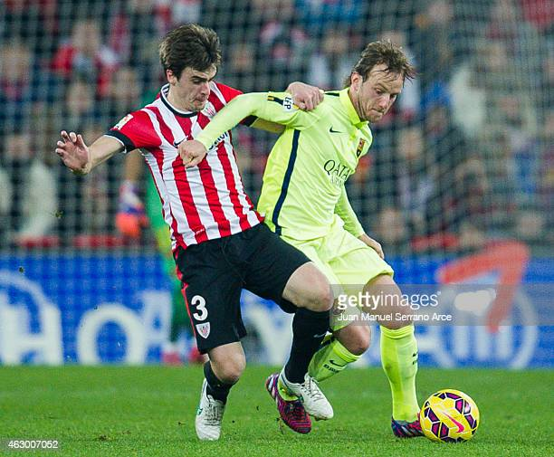 Ivan Rakitic of FC Barcelona duels for the ball with Jon Aurtenetxe of Athletic Club during the La Liga match between Athletic Club and FC Barcelona...